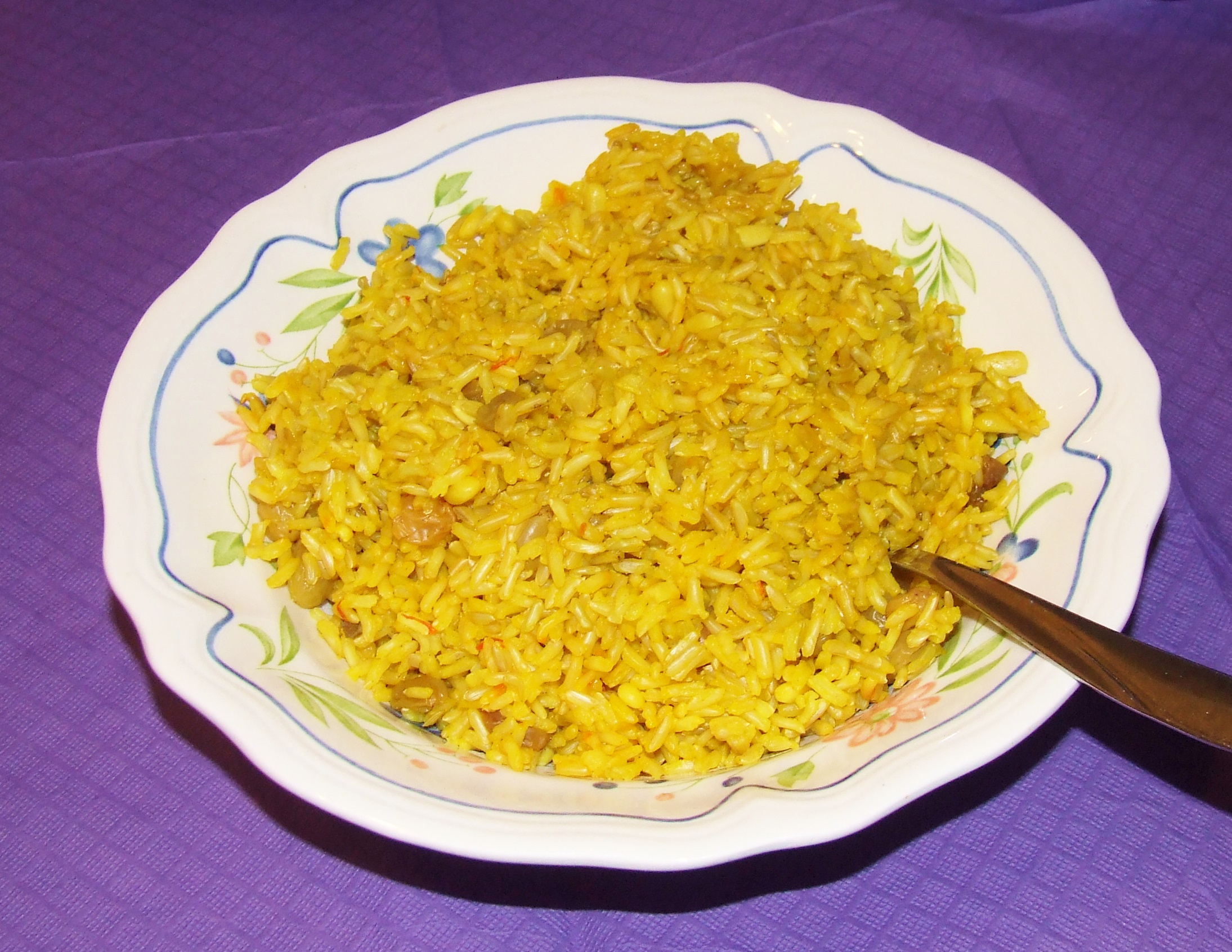 rice saffron rice spoon the rice into a serving with saffron rice ...